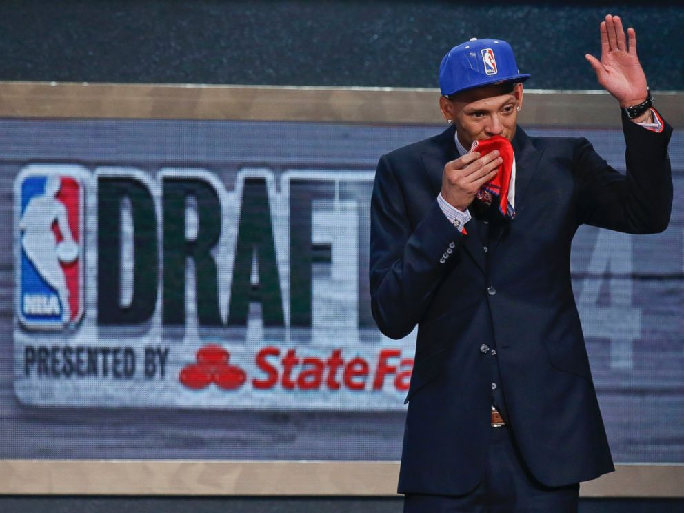 PHOTO: Baylor center Isaiah Austin waves to the crowd after being granted a ceremonial first round pick during the 2014 NBA Draft, June 26, 2014, in New York.