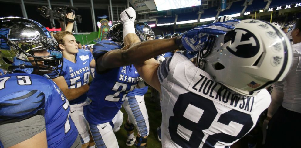 PHOTO: Players scuffle after Memphis defeated Brigham Young, 55-48 in double overtime during the inaugural Miami Beach Bowl football game, Dec. 22, 2014 in Miami.