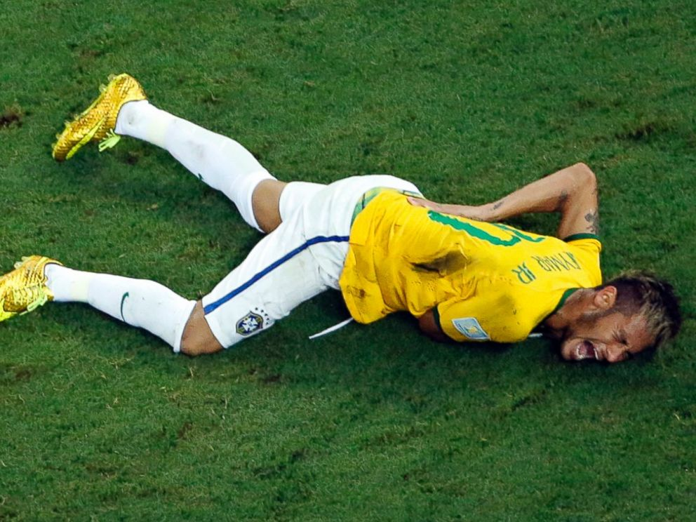 PHOTO: Brazils Neymar grimaces in pain during the World Cup quarterfinal soccer match between Brazil and Colombia at the Arena Castelao in Fortaleza, Brazil, Friday, July 4, 2014. Brazils team doctor says Neymar will miss the rest of the World Cup.