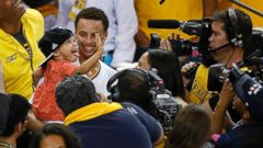 PHOTO: Golden State Warriors guard Stephen Curry holds his daughter Riley after Game 5 of the NBA basketball Western Conference finals against the Houston Rockets in Oakland, Calif., May 27, 2015.
