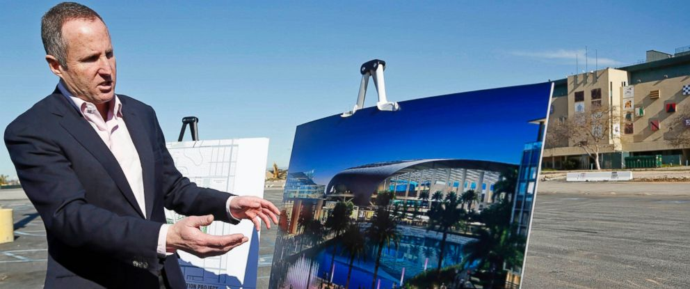 PHOTO: In this Monday, Jan. 5, 2015, file photo, Chris Meany, senior vice president of Hollywood Park Land Company, unveils an architectural rendering of a proposed NFL stadium at Hollywood Park in Inglewood, Calif.