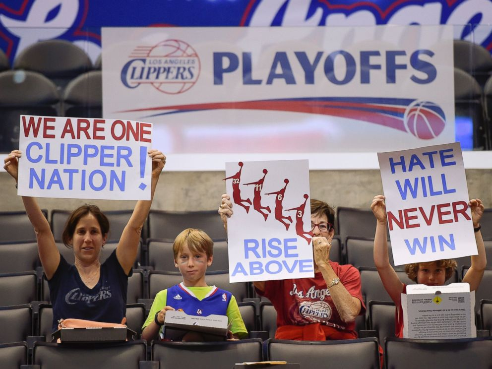 PHOTO: Fans hold up signs in support of the Los Angeles Clippers before Game 5 of an opening-round NBA basketball playoff series between the Clippers and the Golden State Warriors, April 29, 2014, in Los Angeles.