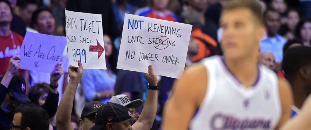 PHOTO: Fans hold up signs as Los Angeles Clippers forward Blake Griffin looks on during the second half in Game 5 of an opening-round NBA basketball playoff series against the Golden State Warriors, Tuesday, April 29, 2014, in Los Angeles.