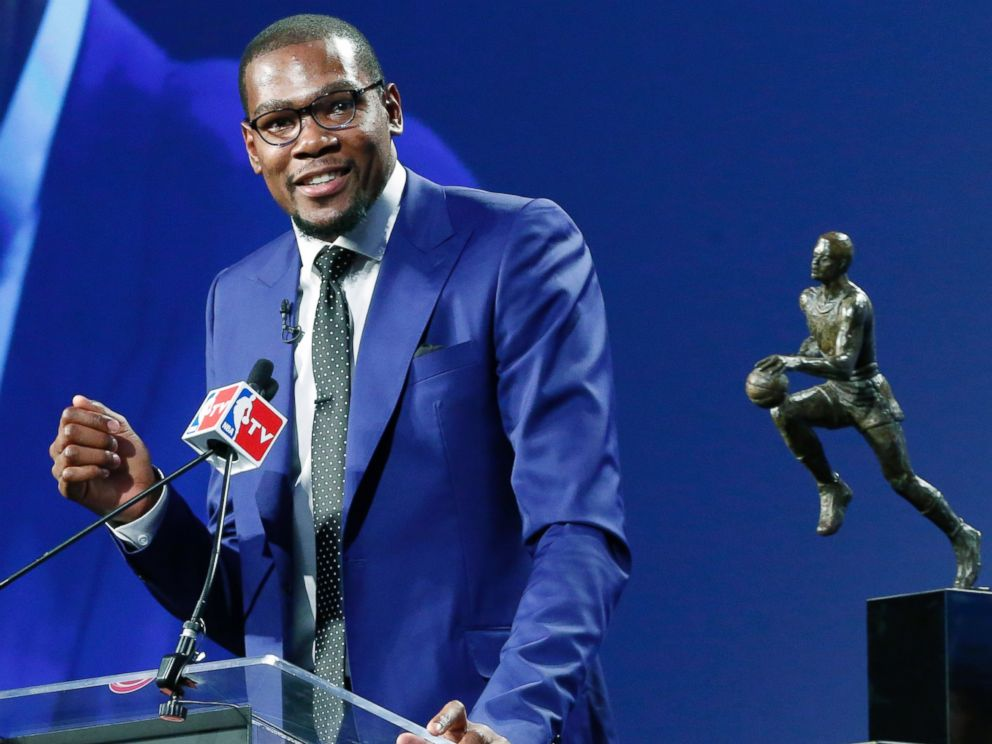 PHOTO: Oklahoma City Thunders Kevin Durant speaks during the news conference announcing him as the winner of the 2013-14 Kia NBA Basketball Most Value Player Award in Oklahoma City, May 6, 2014. The MVP trophy is at right.