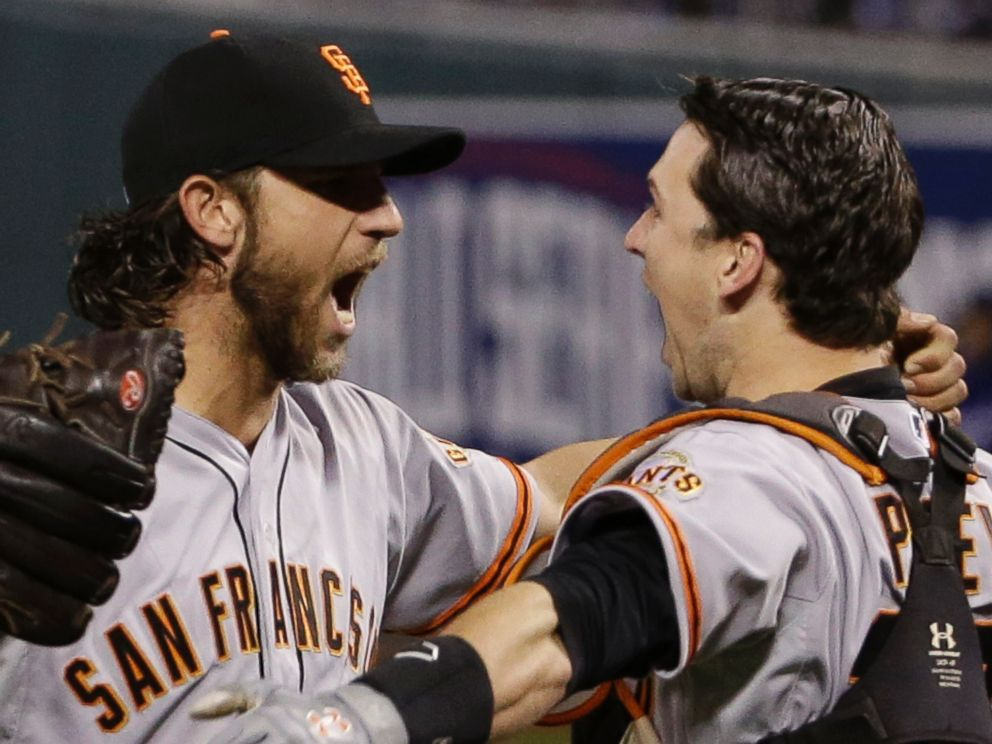 San Francisco Giants pitcher Madison Bumgarner, left, and Buster Posey celebrate after winning 3-2 to win the series over Kansas City Royals after Game 7 of baseballs World Series Wednesday, Oct. 29, 2014, in Kansas City, Mo.