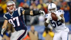 In this Sunday, Jan. 18, 2015, photo, Indianapolis Colts inside linebacker DQwell Jackson (52) intercepts a pass intended for New England Patriots tight end Rob Gronkowski during the first half of the AFC championship NFL football game.