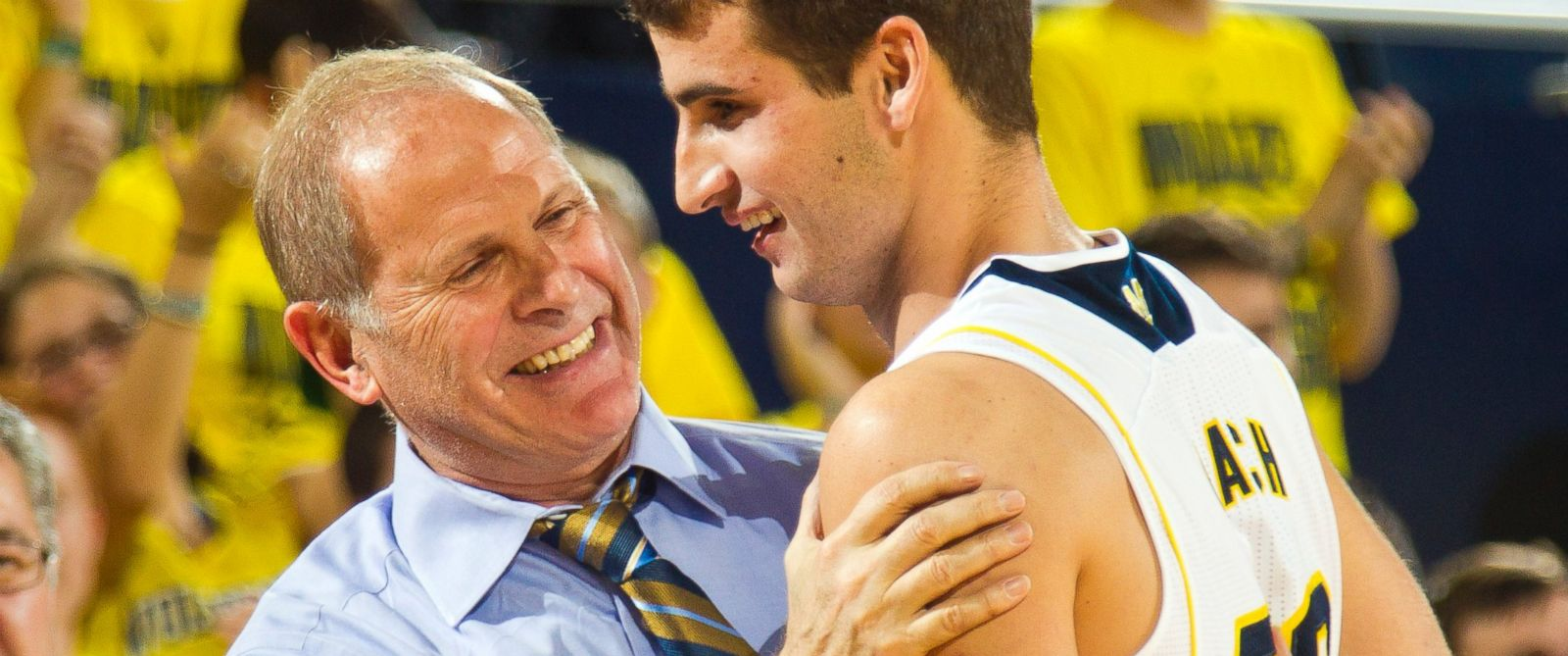 Michigan head coach John Beilein congratulates guard Austin Hatch after he made a free throw basket in the second half of an NCAA college basketball exhibition game against Wayne State at Crisler Center in Ann Arbor, Mich., Nov. 10, 2014.