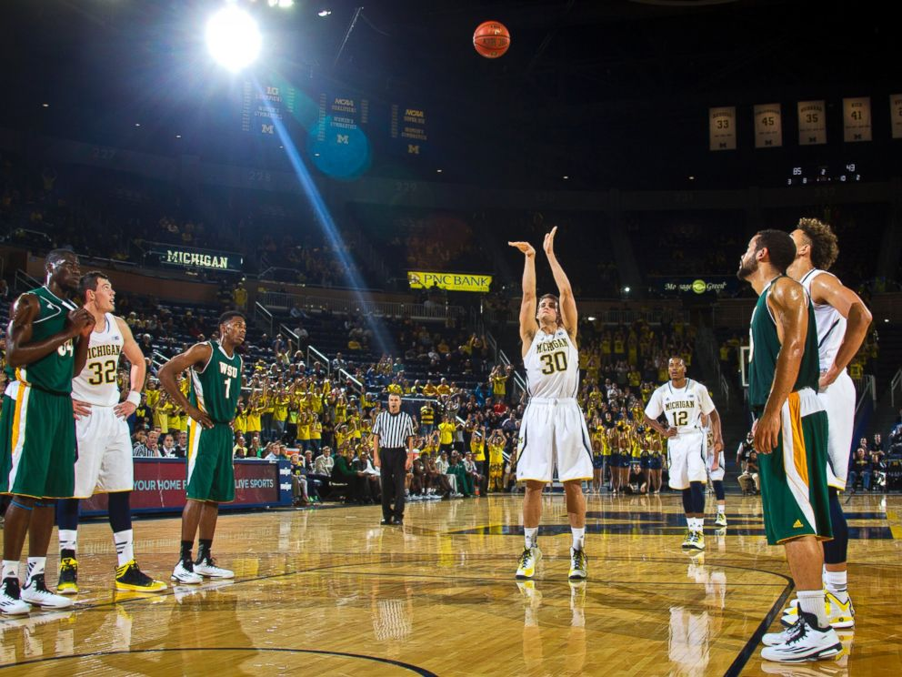 Michigan guard Austin Hatch makes a free throw in the second half of an NCAA college basketball exhibition game against Wayne State at Crisler Center in Ann Arbor, Mich., Nov. 10, 2014.
