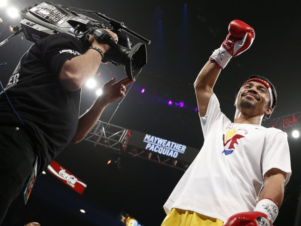 PHOTO: Manny Pacquiao, from the Philippines, acknowledges the crowd before the start of his world welterweight championship bout against Floyd Mayweather Jr., on Saturday, May 2, 2015 in Las Vegas.