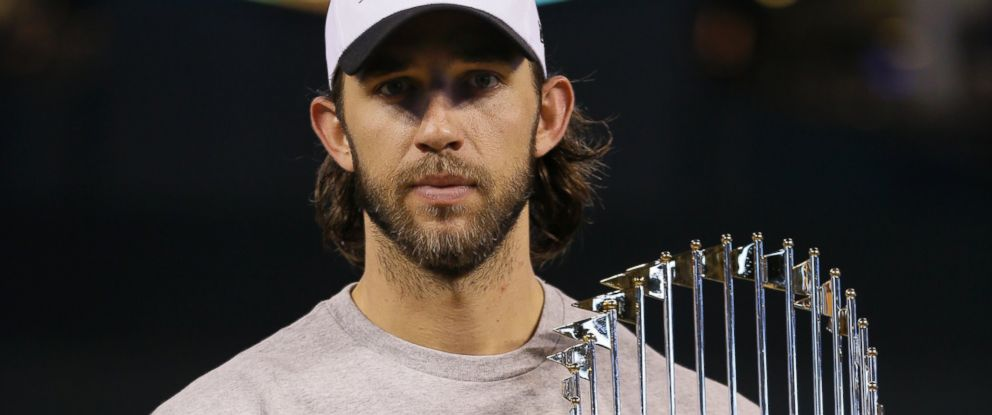 San Francisco Giants pitcher Madison Bumgarner holds the World Series trophy after Game 7 of baseballs World Series Thursday, Oct. 30, 2014, in Kansas City, Mo. The Giants defeated the Kansas City Royals 3-2 to win the series.