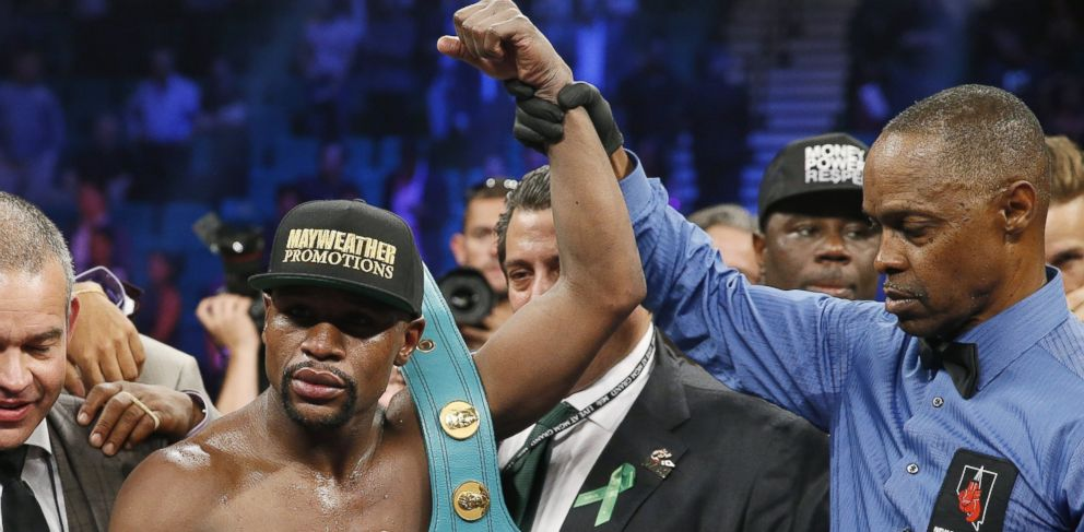 PHOTO: Floyd Mayweather Jr., celebrates his victory over Manny Pacquiao, from the Philippines, with the champions belt following their welterweight title fight on Saturday, May 2, 2015 in Las Vegas.