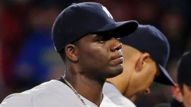 PHOTO: Home plate umpire Gerry Davis ejects New York Yankees starting pitcher Michael Pineda after a foreign substance was discovered on his neck, April 23, 2014.