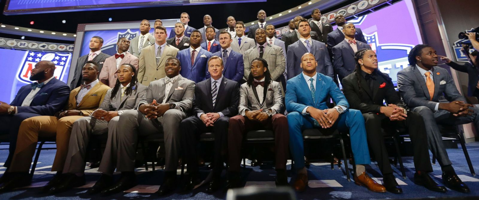 PHOTO: NFL draftees pose with commissioner Roger Goodell at the start of the 2014 NFL Draft, Thursday, May 8, 2014, in New York.