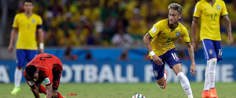 PHOTO: Brazils Neymar runs with the ball during the group A World Cup soccer match between Brazil and Mexico at the Arena Castelao in Fortaleza, Brazil, June 17, 2014.