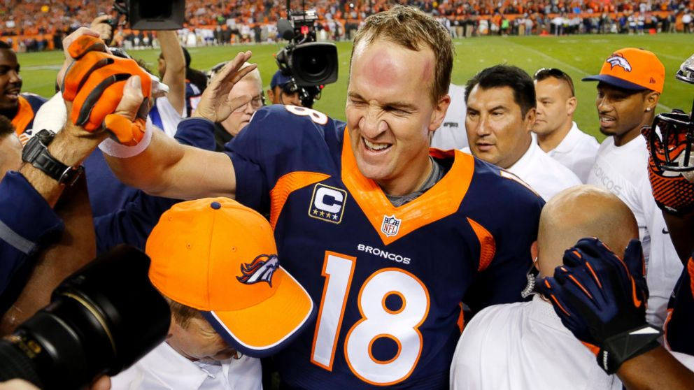 Denver Broncos quarterback Peyton Manning celebrates his 509th career touchdown pass with teammates during the first half of an NFL football game against the San Francisco 49ers, Oct. 19, 2014, in Denver.