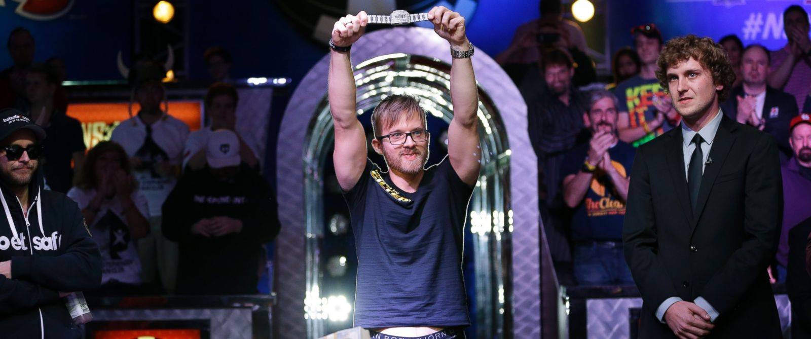 Martin Jacobson holds up the World Series of Poker main event bracelet after winning the tournament and its $10 million prize, Nov. 11, 2014, in Las Vegas.