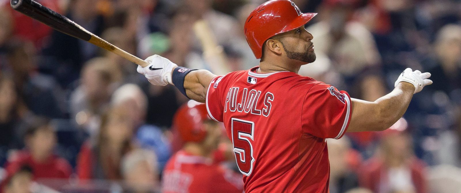 PHOTO: Los Angeles Angels first baseman Albert Pujols watches the ball after connecting for his 500th career home run,April 22, 2014.