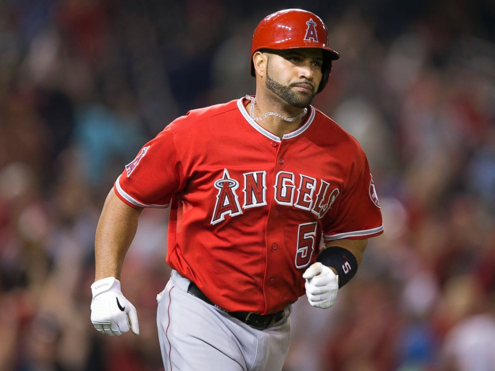 PHOTO: Albert Pujols circles the bases after hitting his 500th career home run, April 22, 2014.