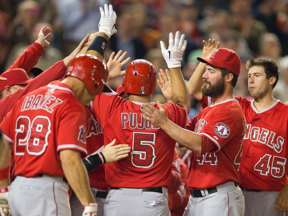 PHOTO: Teammates greet Albert Pujols after his 500th career home run, April 22, 2014.