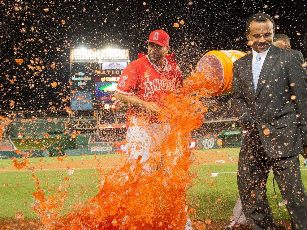 PHOTO: Los Angeles Angels Albert Pujols is showered with a buckle of Gatorade by his teammates during an on on-air interview, April 22, 2014 in Washington.