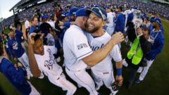 Kansas City Royals Alex Gordon, right, celebrates with teammates after the Royals defeated the Baltimore Orioles to win the American League baseball championship series, Oct. 15, 2014, in Kansas City, Mo.