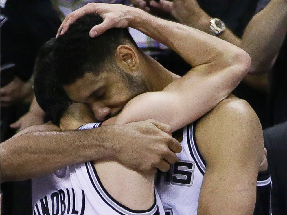 PHOTO: San Antonio Spurs guard Manu Ginobili, left, and forward Tim Duncan embrace in the final moments of Game 5 of the NBA basketball finals against the Miami Heat, June 15, 2014, in San Antonio.
