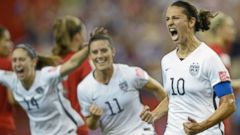 United States Carli Lloyd celebrates with teammates Ali Krieger and Morgan Brian after scoring on a penalty kick against Germany during the second half of a semifinal in the Womens World Cup finals, Tuesday, June 30, 2015, in Montreal, Canada.