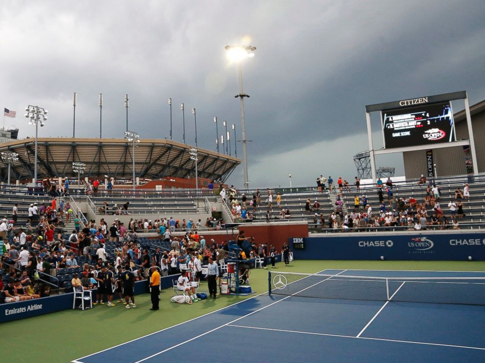 Play is suspended as storm clouds roll over the Billie Jean King National Tennis Center because of imminent lighting during the 2014 U.S. Open tennis tournament, Sunday, Aug. 31, 2014, in New York.