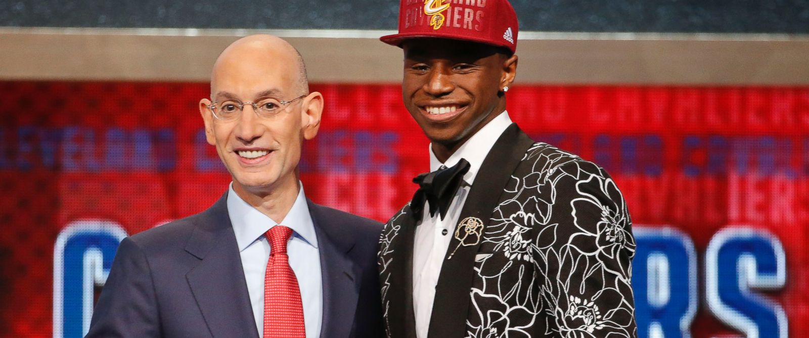 PHOTO: NBA Commissioner Adam Silver, left, congratulates Andrew Wiggins of Kansas who was selected by the Cleveland Cavaliers as the number one pick in the 2014 NBA draft, June 26, 2014, in New York.