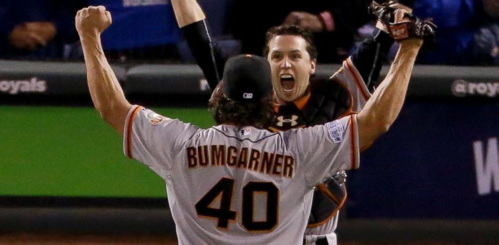 San Francisco Giants starting pitcher Madison Bumgarner, left, and catcher Buster Posey celebrate 3-2 win against the Kansas City Royals in Game 7 of baseballs World Series Wednesday, Oct. 29, 2014, in Kansas City, Mo.