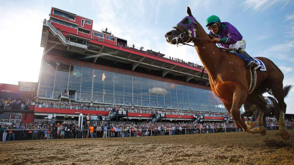 PHOTO: California Chrome, ridden by jockey Victor Espinoza, wins the 139th Preakness Stakes horse race at Pimlico Race Course, Saturday, May 17, 2014, in Baltimore.