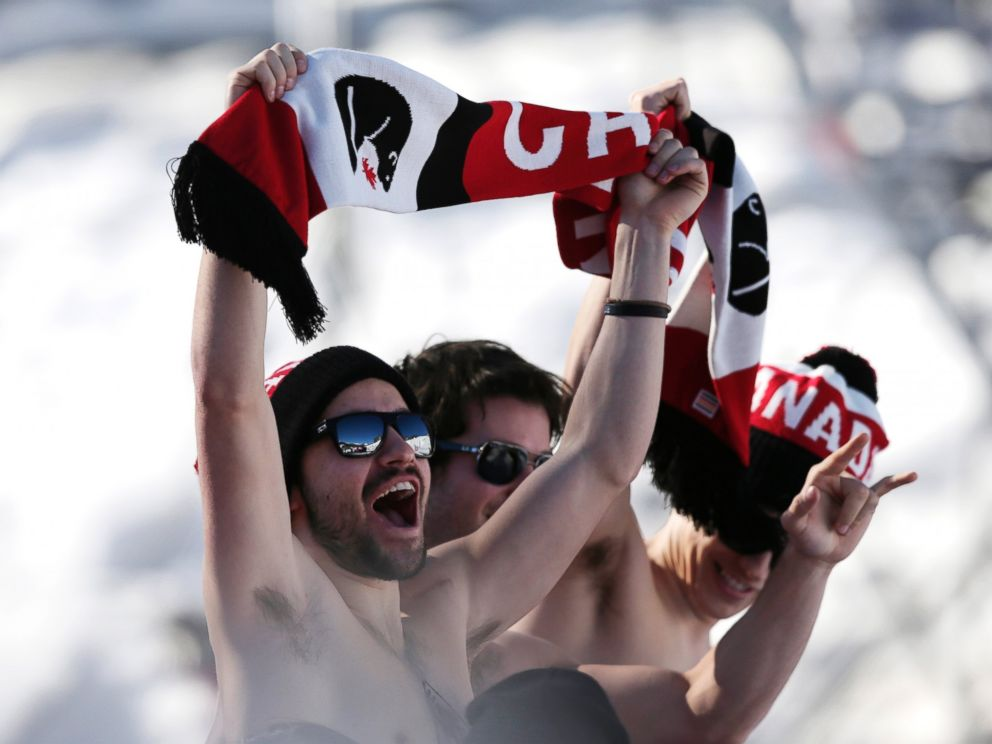 PHOTO: Canadian fans cheer during the mens ski slopestyle qualifying at the Rosa Khutor Extreme Park, at the 2014 Winter Olympics, Feb. 13, 2014, in Krasnaya Polyana, Russia.