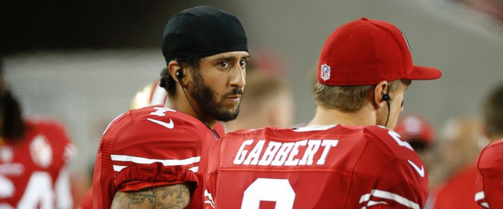 PHOTO: San Francisco 49ers quarterbacks Colin Kaepernick, left, and Blaine Gabbert stand on the sideline during the second half of an NFL preseason football game against the Green Bay Packers, Aug. 26, 2016, in Santa Clara, California.