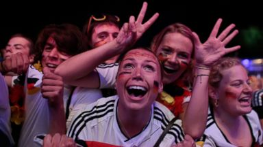 PHOTO: German soccer fans celebrate after their team won the Brazil World Cup semi final being played in Belo Horizonte, Brazil, between Germany and Brazil at a public viewing event called Fan Mile in Berlin, Tuesday, July 8, 2014.