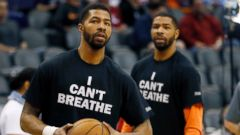 PHOTO: Phoenix Suns Markieff Morris, left, and his brother, Marcus Morris, warm up prior to an NBA basketball game against the Milwaukee Bucks, Monday, Dec. 15, 2014, in Phoenix.