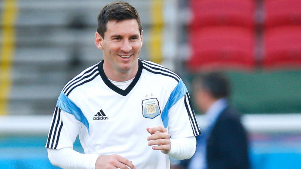 PHOTO: Argentinas Lionel Messi warms up during a training session at the Beira-Rio Stadium in Porto Alegre, Brazil, June 24, 2014.