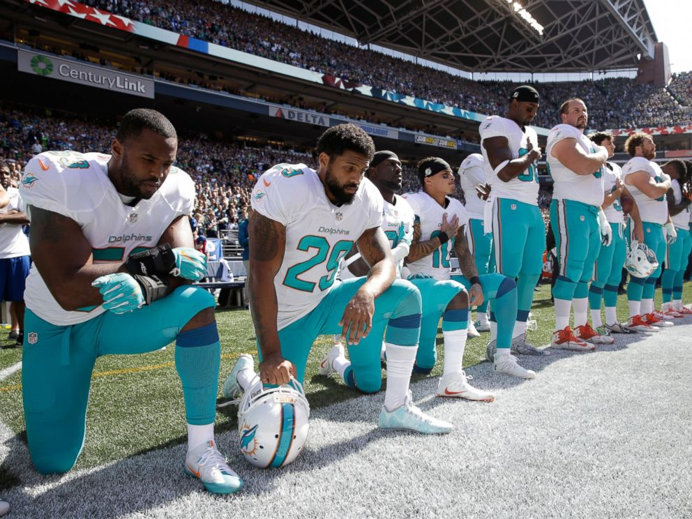 PHOTO: From left, Miami Dolphins Jelani Jenkins, Arian Foster, Michael Thomas, and Kenny Stills, kneel during the singing of the national anthem before an NFL football game against the Seattle Seahawks, Sept. 11, 2016, in Seattle.