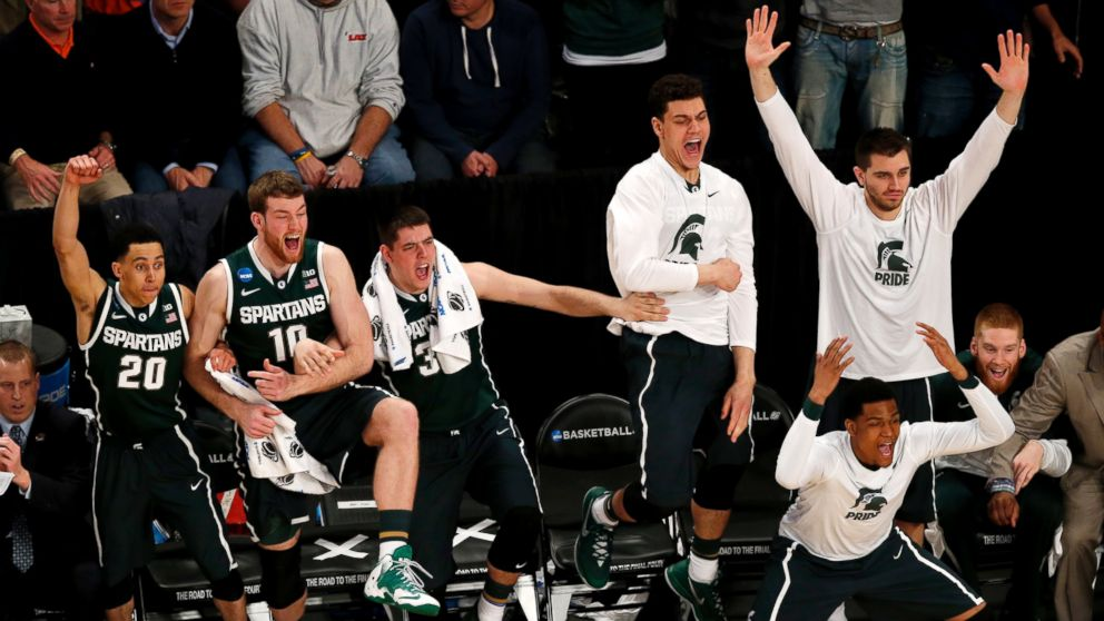 PHOTO: Michigan State players react during second half in a regional semifinal against Virginia at the NCAA mens college basketball tournament, early Saturday, March 29, 2014, in New York.