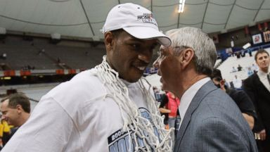 PHOTO: North Carolina coach Roy Williams is shown chatting with Rashad McCants after defeating Wisconsin 88-82 to win the NCAA East Regional in Syracuse, N.Y., March 27, 2005.