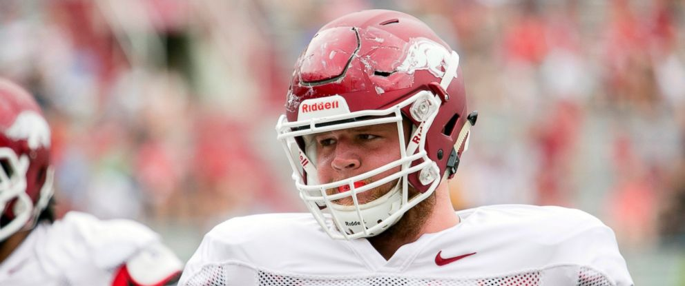 PHOTO: Arkansas guard Brey Cook wears a Riddell SpeedFlex helmet during a preseason NCAA college football practice in Fayetteville, Ark. in this file photo, Aug 16, 2014.