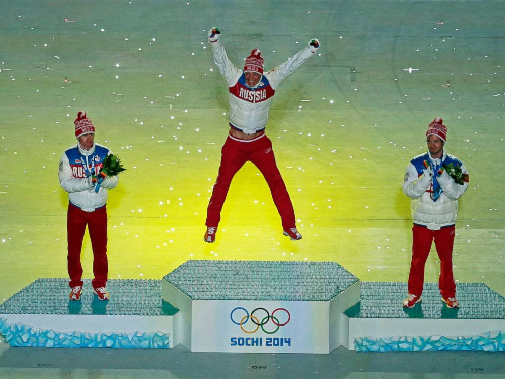 PHOTO: Russias medal winners pose during the medal ceremony for the mens 50-kilometer cross-country race during the closing ceremony of the 2014 Winter Olympics, Sunday, Feb. 23, 2014, in Sochi, Russia.