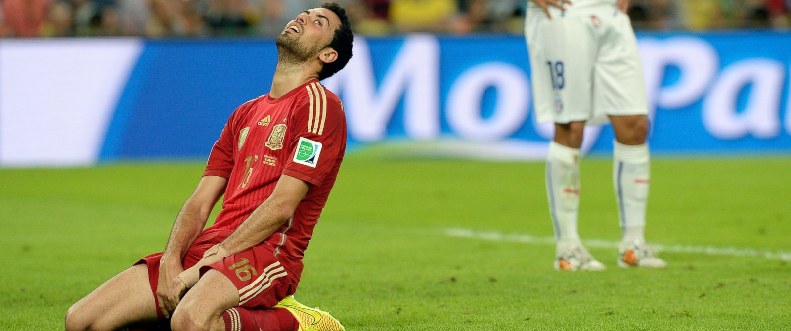 PHOTO: Spains Sergio Busquets reacts after missing a chance during the group B World Cup soccer match between Spain and Chile at the Maracana Stadium in Rio de Janeiro, Brazil, June 18, 2014.