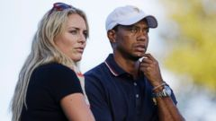 PHOTO: Tiger Woods and Lindsey Vonn are shown watching at the Presidents Cup golf tournament at Muirfield Village Golf Club in Dublin, Ohio, Oct. 3, 2013.