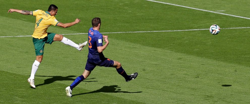 PHOTO: Australias Tim Cahill, left, scores his sides first goal during the group B World Cup soccer match between Australia and the Netherlands at the Estadio Beira-Rio in Porto Alegre, Brazil, June 18, 2014.