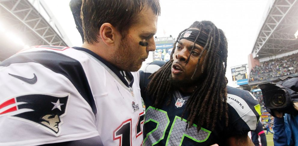 PHOTO: New England Patriots quarterback Tom Brady and Seattle Seahawks Richard Sherman speak after an NFL football game, Oct. 14, 2012, in Seattle.