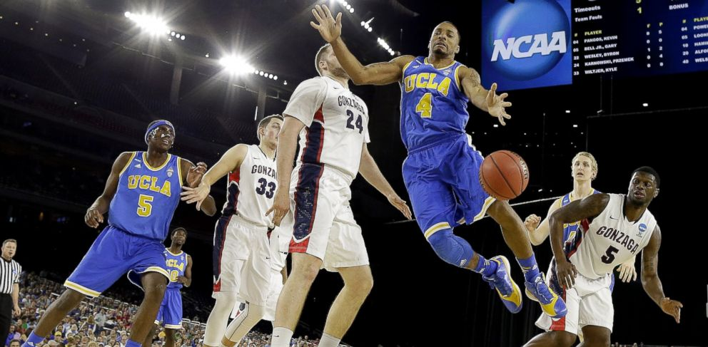 PHOTO: UCLAs Norman Powell (4) loses the ball in front of Gonzagas Przemek Karnowski (24) during the first half of a college basketball regional semifinal game in the NCAA Tournament, March 27, 2015, in Houston.