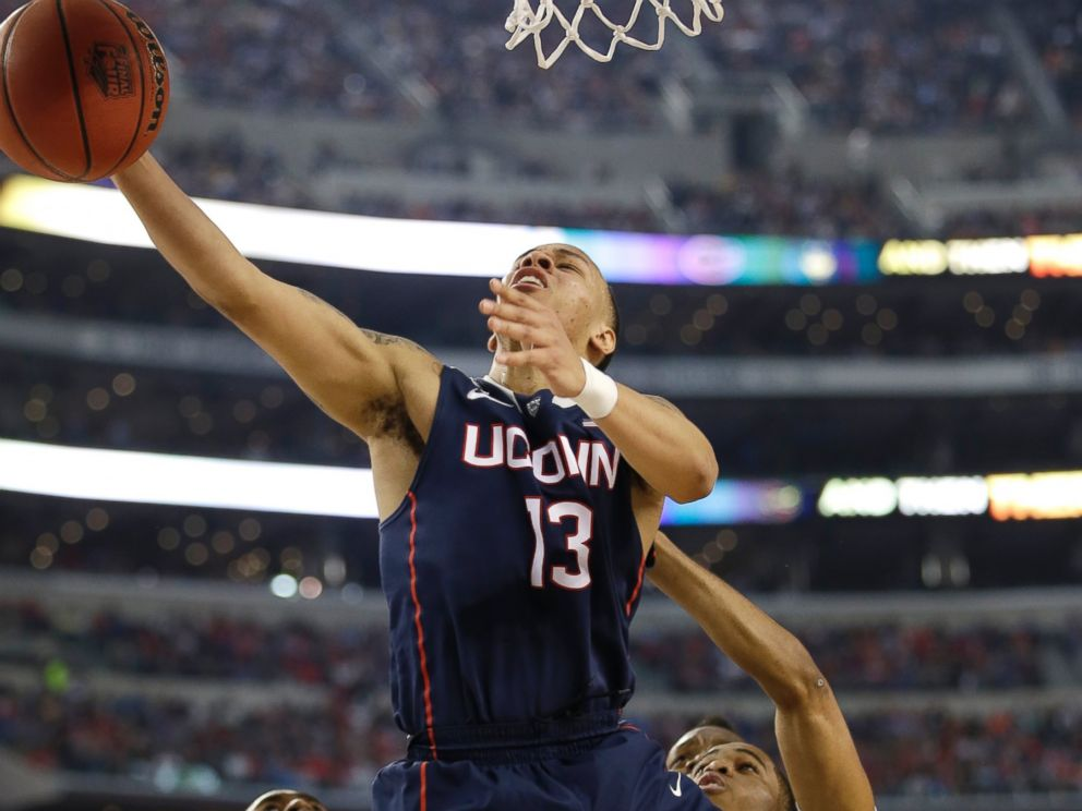 PHOTO: Connecticut guard Shabazz Napier drives to the basket during the first half of an NCAA Final Four tournament semifinal game, April 5, 2014, in Arlington, Texas.