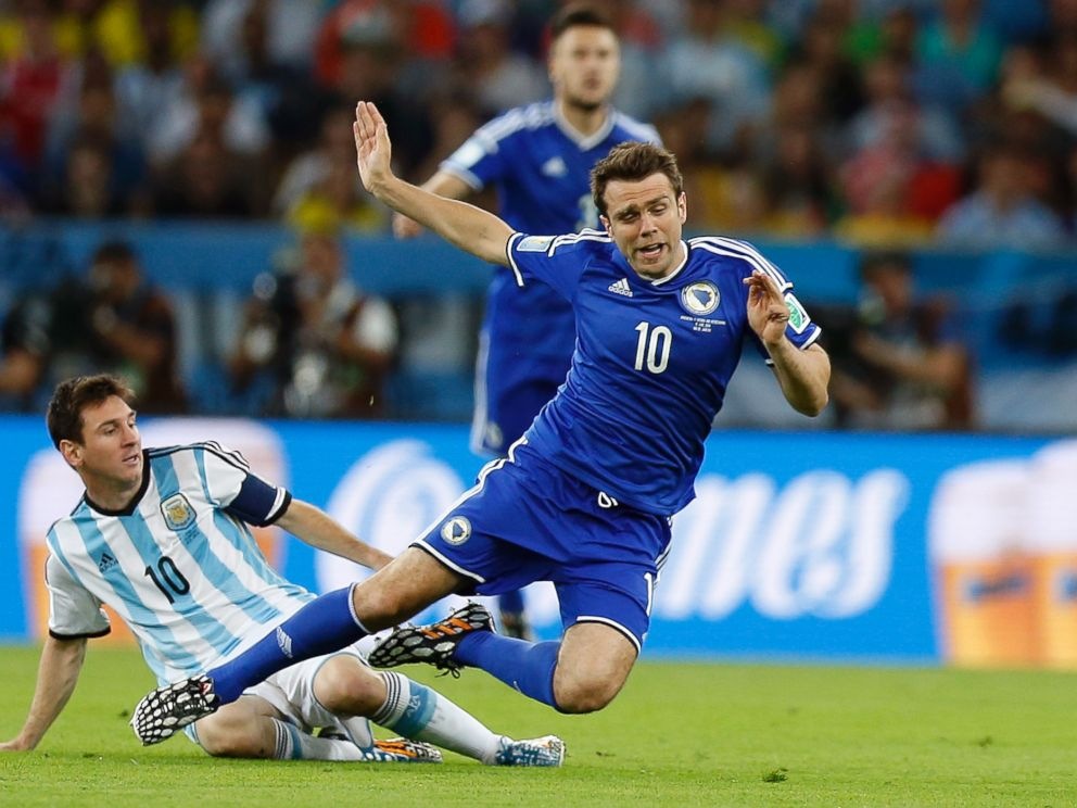 PHOTO: Argentinas Lionel Messi, left, fouls Bosnias Zvjezdan Misimovic during the group F World Cup soccer match between Argentina and Bosnia at the Maracana Stadium in Rio de Janeiro, Brazil, Sunday, June 15, 2014.
