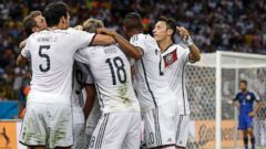 PHOTO: Germany players celebrate scoring the opening goal during the World Cup final soccer match between Germany and Argentina at the Maracana Stadium in Rio de Janeiro, July 13, 2014.