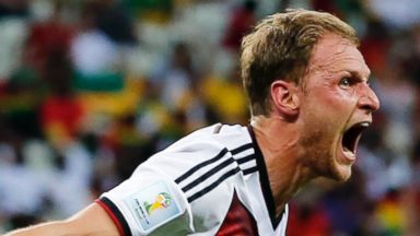 PHOTO: Germanys Benedikt Hoewedes celebrates after his teammate Miroslav Klose scored a goal during the group G World Cup soccer match between Germany and Ghana at the Arena Castelao in Fortaleza, Brazil, Saturday, June 21, 2014.